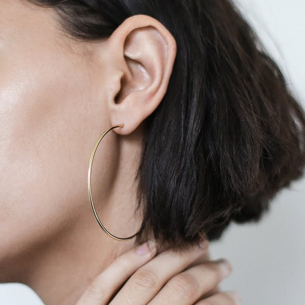 """2.5"""" Classic Gold Hoops on model"""