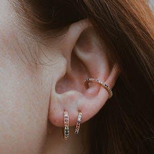 Rainbow Eternity Hoop Earrings on model