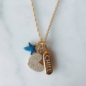 Itty Bitty Turquoise Wishing Star in Gold Vermeil on table