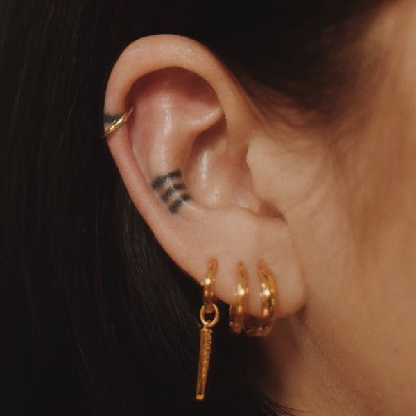Classic Cartilage Hoop in 14k Gold on model