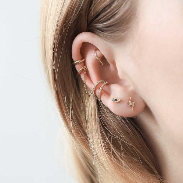 Large Whispering Star Open Hoop Earrings on model