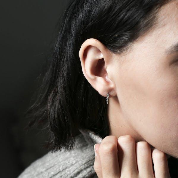 Colette Earrings in Sterling Silver on model