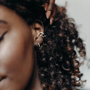 Comet Twirl Earrings in Gold Vermeil on model