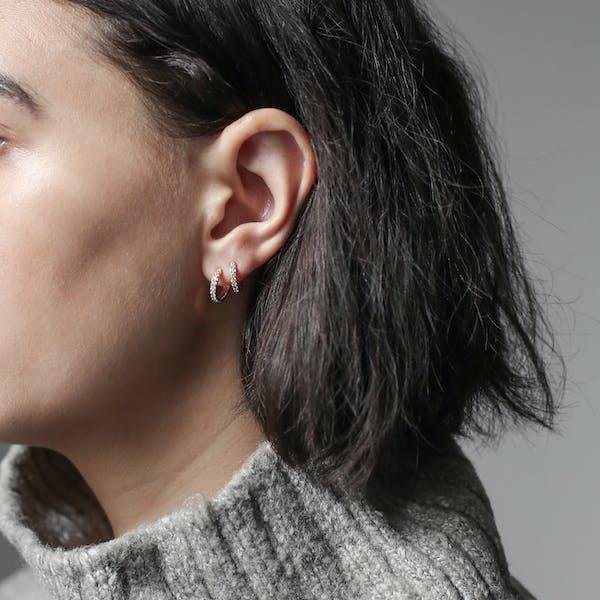 Mini Eternity Hoop Earrings in Sterling Silver on model