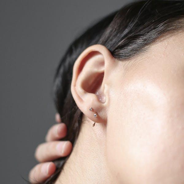 Crystal Huggie Earrings in Sterling Silver on model