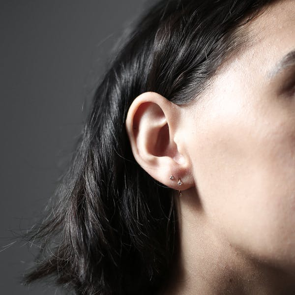 Crystal Huggie Earrings on model