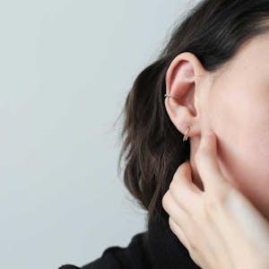 Large Whisper Open Hoop Earrings in Sterling Silver on model