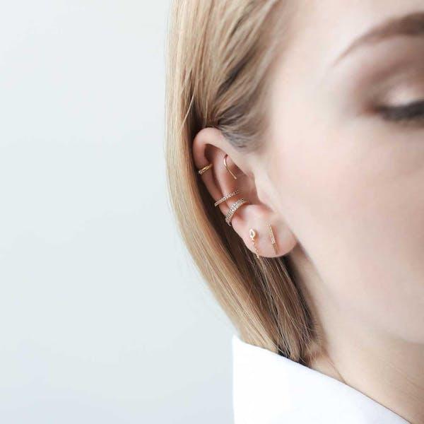 Large Whispering Star Open Hoop Earrings in Sterling Silver on model