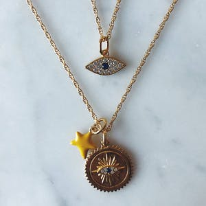 Itty Bitty Yellow Wishing Star in Gold Vermeil on table