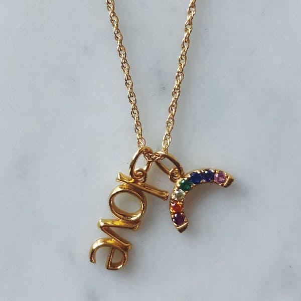 Rainbow Charm in Gold Vermeil on table