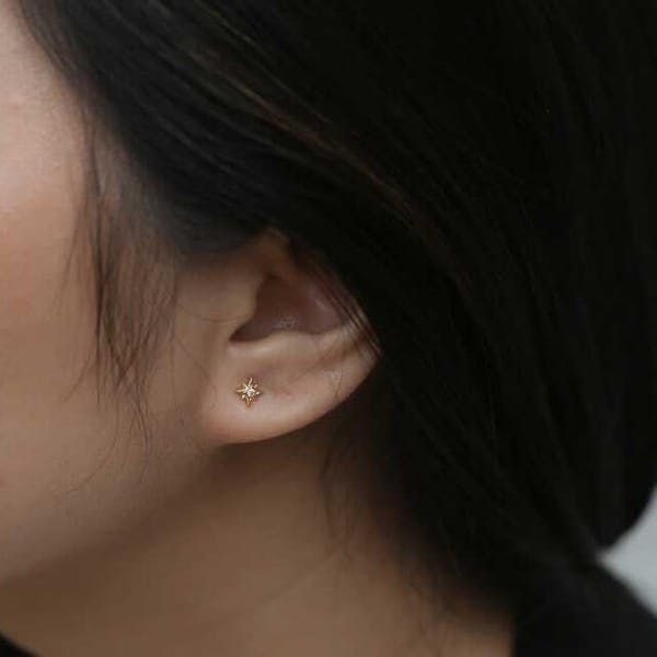 North Star Threaded Flat Back Earring in Gold on model