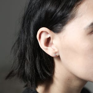 Tiny Crystal Studs in Sterling Silver on model