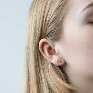 Little Bar Nap Earrings on model