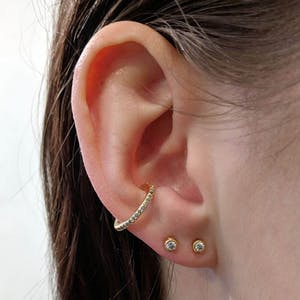 Tiny Sapphire Studs in 14k Gold on model