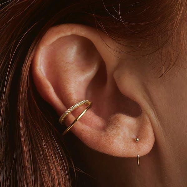 Tiny Secret Nose Hoop Ring in 14k Gold (8mm) on model