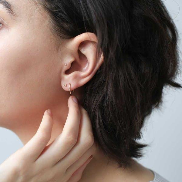 Large Shooting Star Open Hoop Earrings on model