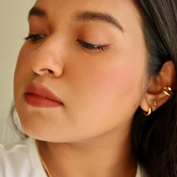 Tiny Secret Stud L-Shape Nose Ring in 14k Gold on model