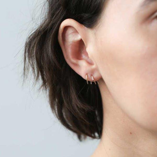 Whispering Star Open Hoop Earrings in Sterling Silver on model