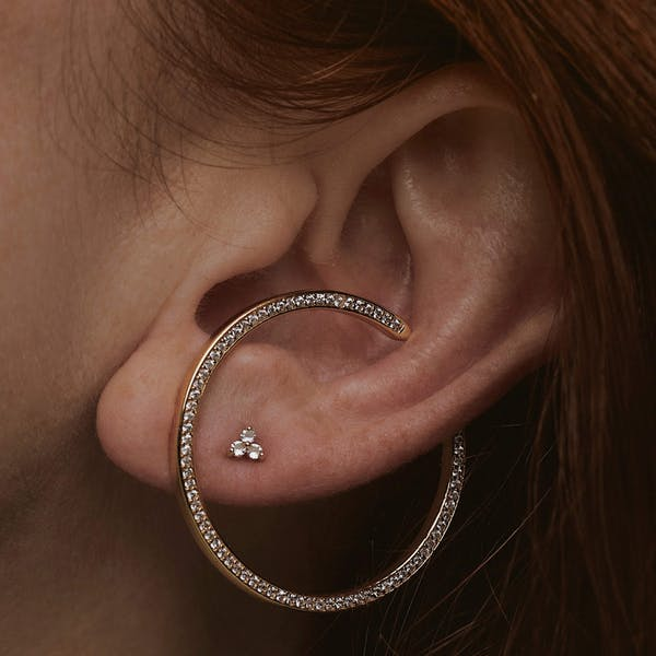 Celestial Illusion Hoops in Sterling Silver on model
