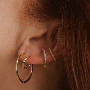 """Classic 1"""" Hoops in Sterling Silver on model"""