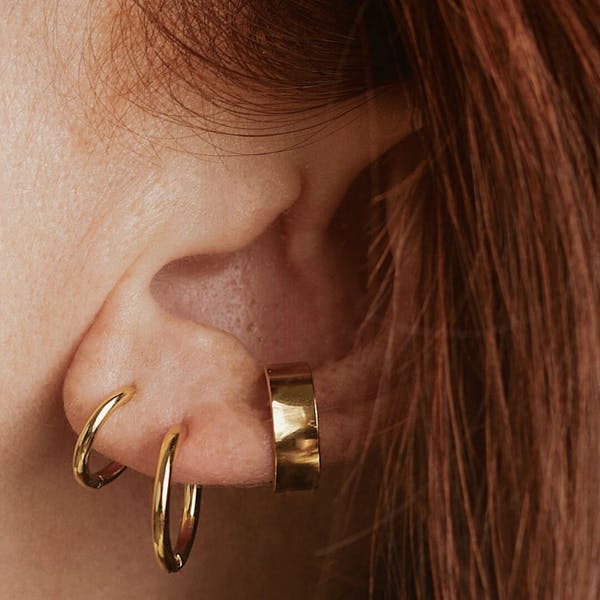 Classic Huggie Hoops in Rose Gold on model