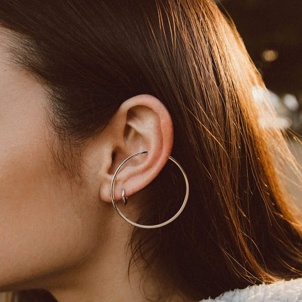 Large Illusion Hoops in Sterling Silver on model