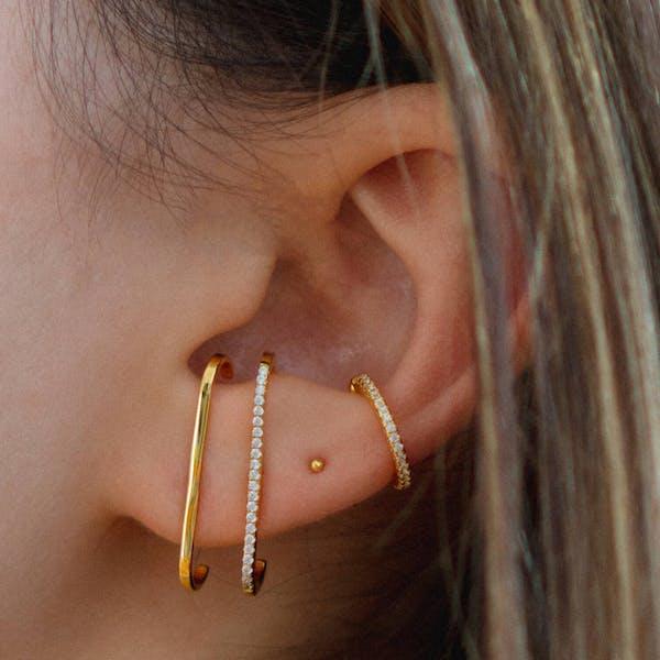 Tiny Secret Ball Back Earrings in 14k Gold on model