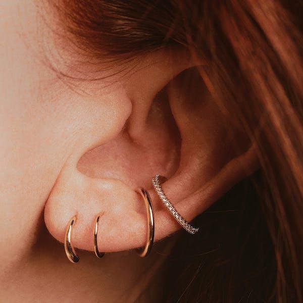 Classic Twirl Earrings in Sterling Silver on model