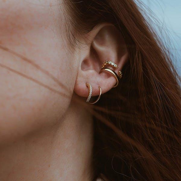 Comet Twirl Earrings on model