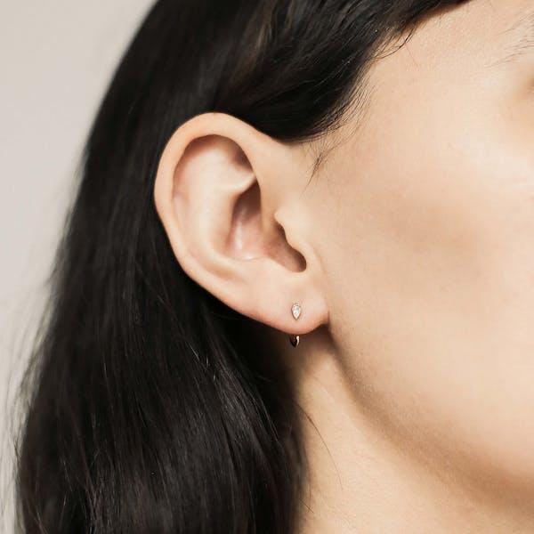 Dewdrop Huggie Earrings in Sterling Silver on model