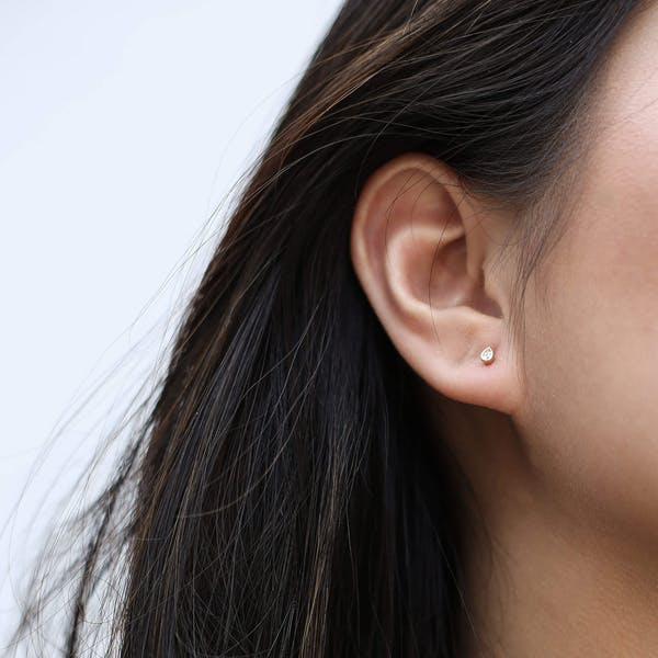 Tiny Dewdrop Threaded Flat Back Earring in Gold on model