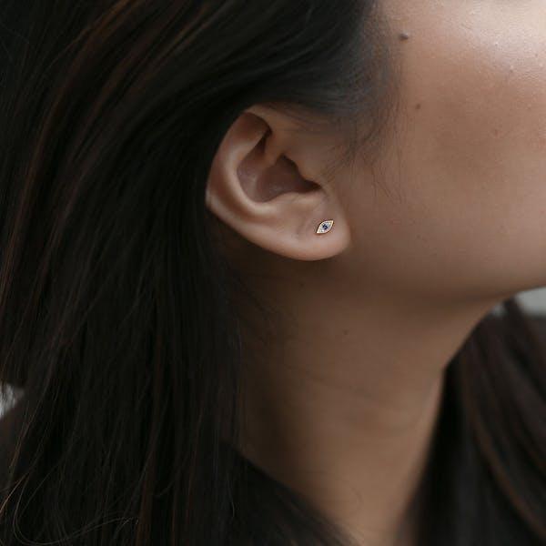 Evil Eye Push Pin Flat Back Earring in Gold on model