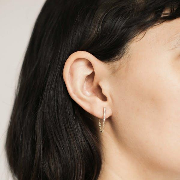Falling Star Crystal Chain Earrings in Sterling Silver on model