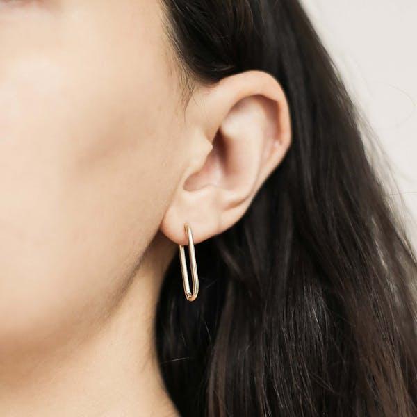 Halo Oval Hoop Earrings in Sterling Silver on model
