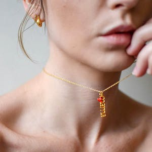 Itty Bitty Red Heart in Gold Vermeil on model