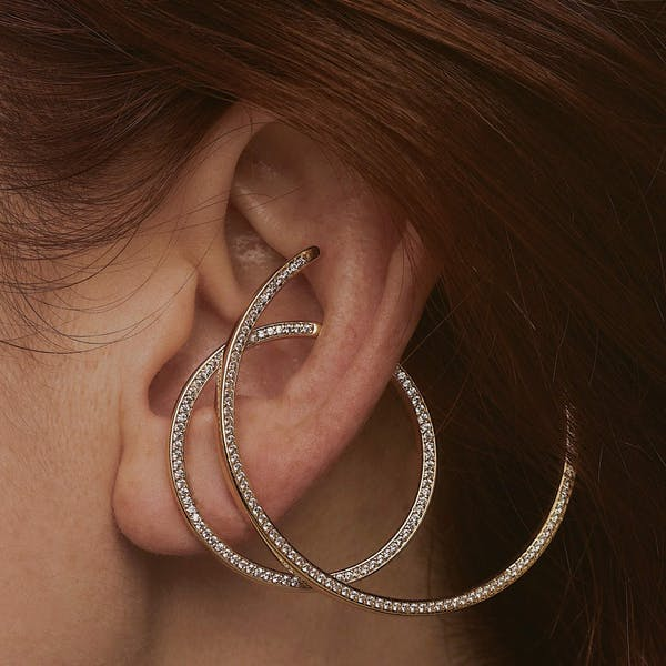 Large Celestial Illusion Hoops in Sterling Silver on model