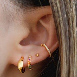Tiny Trinity Ball Back Earrings in 14k Gold on model