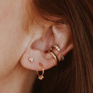 Mini Crystal Trinity Nap Earrings on model