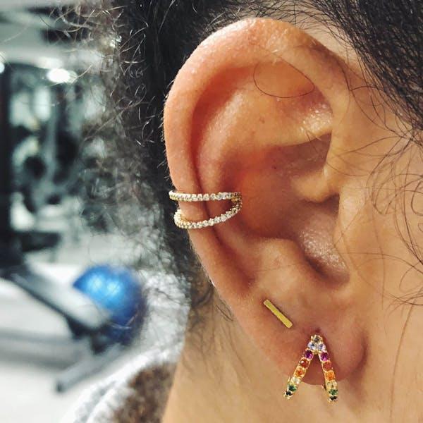 Rainbow Infinite Huggie Earrings in Sterling Silver on model