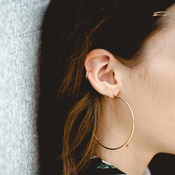 "2.5"" Classic Gold Hoops on model"