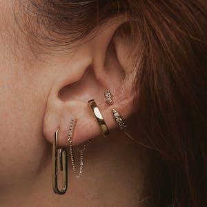 Mini Falling Star Chain Earrings in 14k Gold on model