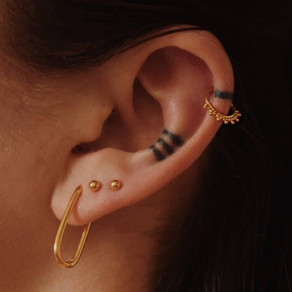Siren Cartilage Hoop in Gold on model