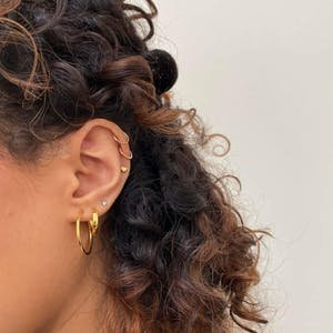 Cosmic Cartilage Hoop in Gold on model