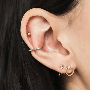Hollow Sphere Studs in 14k Gold on model