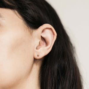Solid Sphere Studs in 14K Gold on model