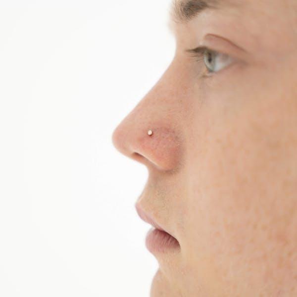 Tiny Diamond Stud L-Shape Nose Ring in 14k Gold on model