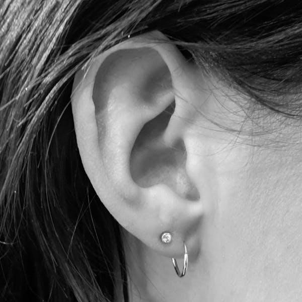 Tiny Sapphire Threaded Flat Back Earring in 14k Gold on model