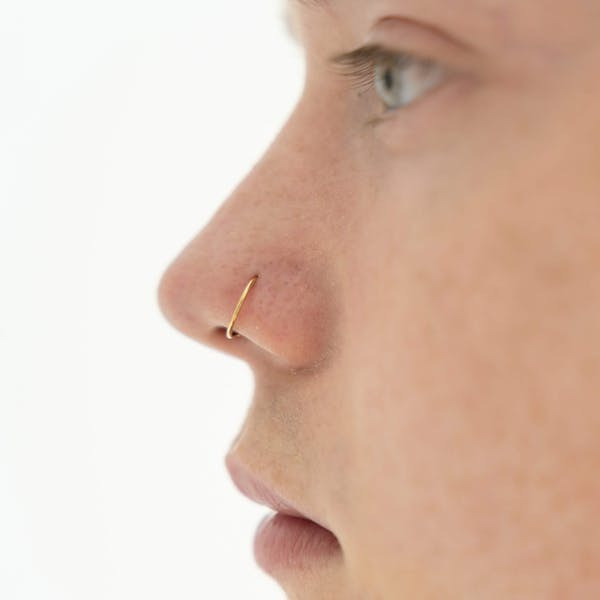 Tiny Secret Nose Hoop Ring in 14k Gold on model
