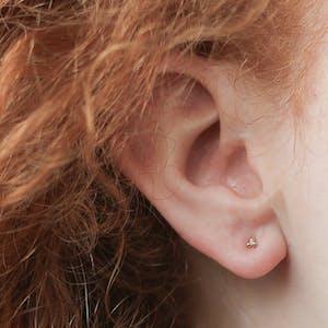 Tiny Trinity Nap Earrings on model